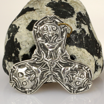 Silver plated bronze brooch.