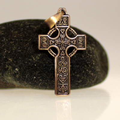 A pendant of a cross adorned with celtic motives.