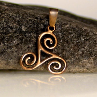 A celtic tirskelion pendant made of bronze.