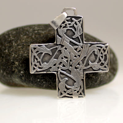A cross with celtic knotworks made of sterling silver