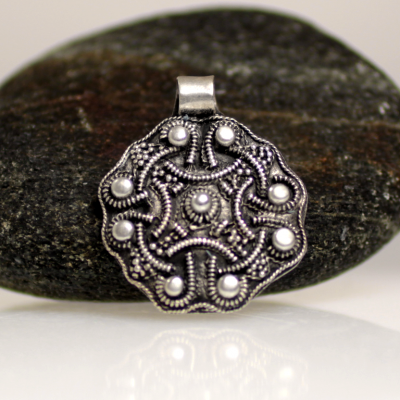 A viking pendant made of filigree silver