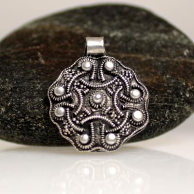 A viking pendant made of filigree silver
